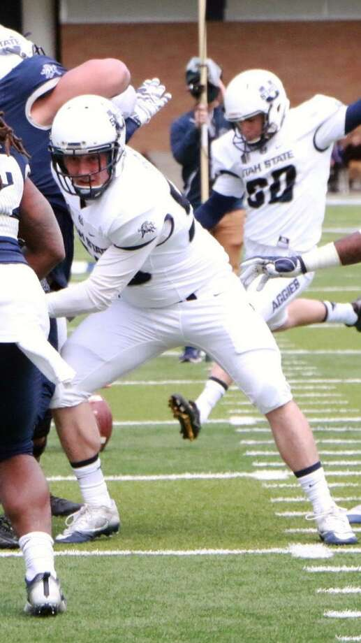 A 2013 Greenwich High School graduate, Emmett Odegard has found his niche as a long snapper on the Utah State football team. Photo: Contributed Photo / Contributed Photo / Greenwich Time Contributed