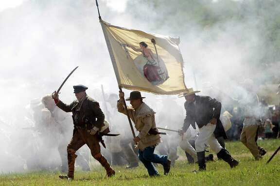 In this photo from April 16, 2011, the 175th anniversary of Texas' independence, re-enactors playing the parts of members of the Texian Army, charge toward the Mexican encampment during the Battle of San Jacinto on the grounds of the San Jacinto Battleground in Houston. ( Karen Warren / Houston Chronicle )
