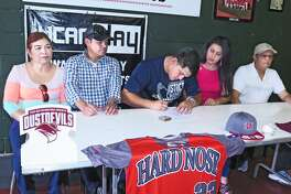 Alexander's Ramon Ballina signed his letter of intent to continue his career at TAMIU on Wednesday at The Hit Zone.