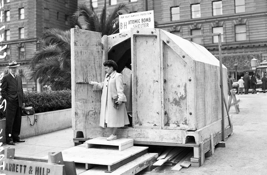 A model of a public bomb shelter went on display in Union Square in 1951. Mayor Elmer Robinson led the charge for public safety in the A-bomb era. Photo: Chronicle File Photo, The Chronicle