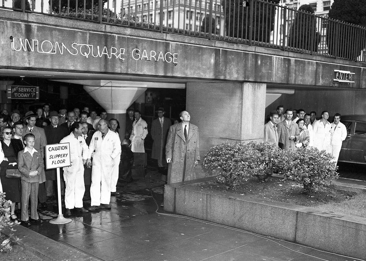 Civilians gather in the Union Square garage during an air raid drill in San Francisco on March 11, 1952.