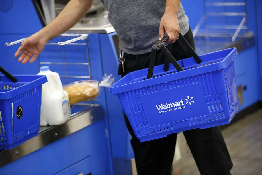 A customer uses a self-checkout kiosk at a Wal-Mart Stores Inc. location in Burbank, California, U.S., on Tuesday, Aug. 8, 2017.Walmart is apologizing after a photo of a back-to-school store sign placed over a glass firearms display started rocketing across social media. Photo: Patrick T. Fallon, Bloomberg