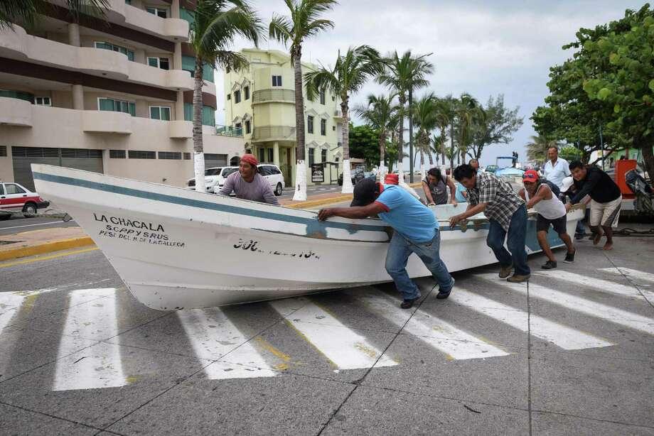 Fishermen push a boat out of the sea Wednesday in anticipation of the arrival of Tropical Storm Franklin in the port city of Veracruz, Mexico.   Photo: VICTORIA RAZO, Contributor / AFP or licensors