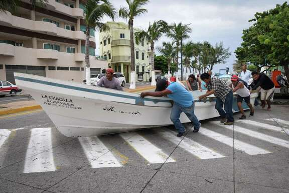Fishermen push a boat out of the sea Wednesday in anticipation of the arrival of Tropical Storm Franklin in the port city of Veracruz, Mexico.