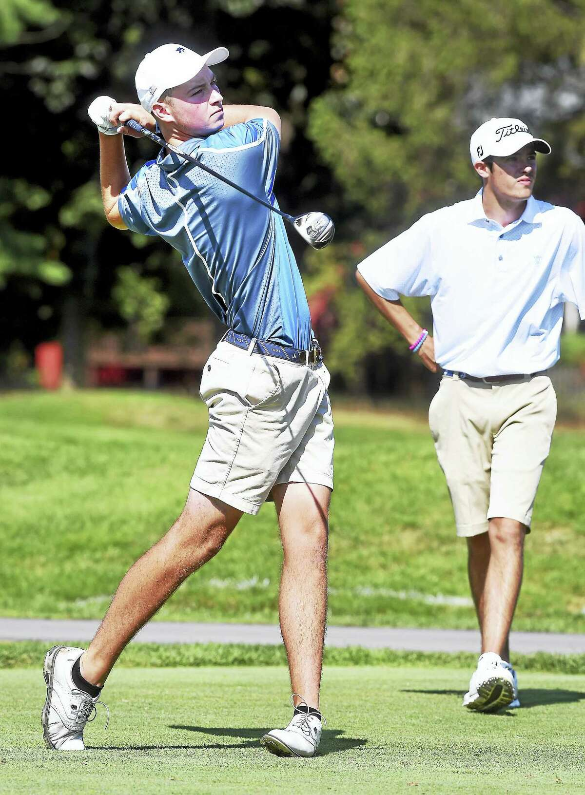 Mark Turner of Gloucester, Massachusetts, drives on the 8th hole of the 16th Northern Junior Championship at New Haven Country Club Wednesday. Turner birdied the last two holes to beat former high school teammate Christopher Francoeur, right, by a shot.