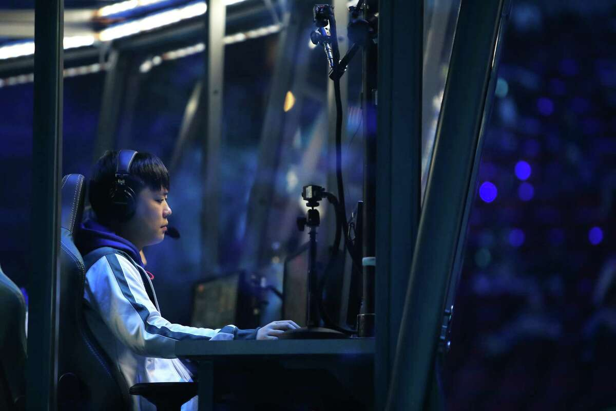 A NewBee player sits at his console as his team plays Invictus Gaming on day three of The International 2017, a tournament for the video game Dota 2, where teams from all over the world compete for $23 million in prize money, Wednesday, Aug. 9, 2017.