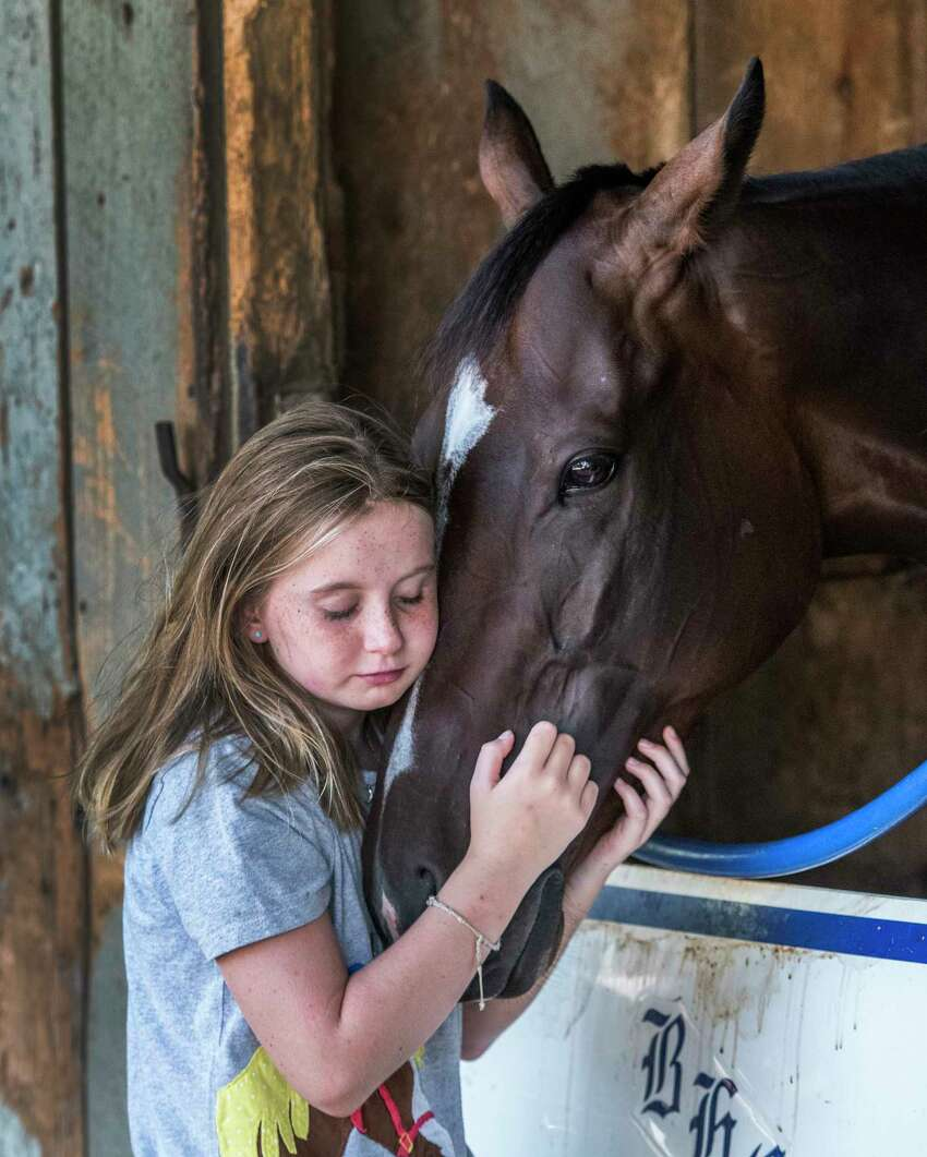 Click through the gallery to look back at last year's Saratoga meet. Amelia Ryan 10, caresses her favorite horse Sassy Little Lila, Wednesday Aug. 9, 2017 at the Oklahoma Training Center in the barn of trainer Brad Cox. Sassy Little Lila is a filly that will run against the boys in Saturday's Fourtstardave,at the Saratoga Race Course in Saratoga Springs, N.Y. (Skip Dickstein/Times Union)