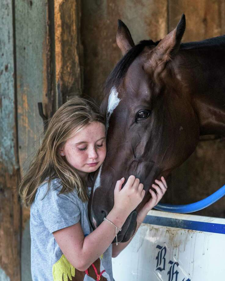 Click through the gallery to look back at last year's Saratoga meet. Amelia Ryan 10, caresses her favorite horse Sassy Little Lila, Wednesday  Aug. 9, 2017 at the Oklahoma Training Center in the barn of trainer Brad Cox. Sassy Little Lila is a filly that will run against the boys in Saturday's Fourtstardave,at the Saratoga Race Course in Saratoga Springs, N.Y.  (Skip Dickstein/Times Union) Photo: SKIP DICKSTEIN