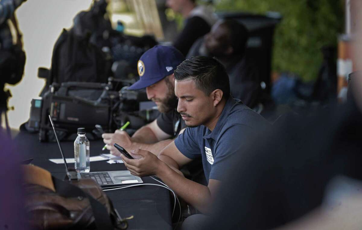 Gilbert Manzano, a sportswriter for the Las Vegas Review-Journal, works in the media center at Napa.