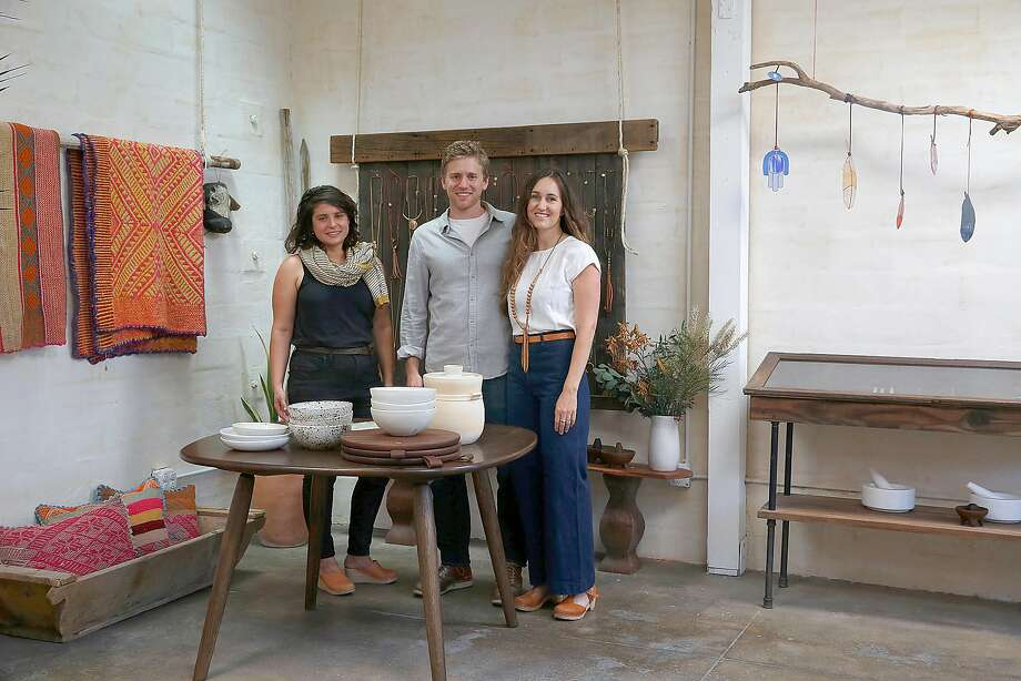 Ceramic designer Sarah Kersten (left), Dave Ball of Jacob May (middle) cutting boards and wooden tables, and his wife jewelry designer Marisa Haskell (right) of Marisa Mason Jewelry at Marisa's studio. Photo: Liz Hafalia, The Chronicle