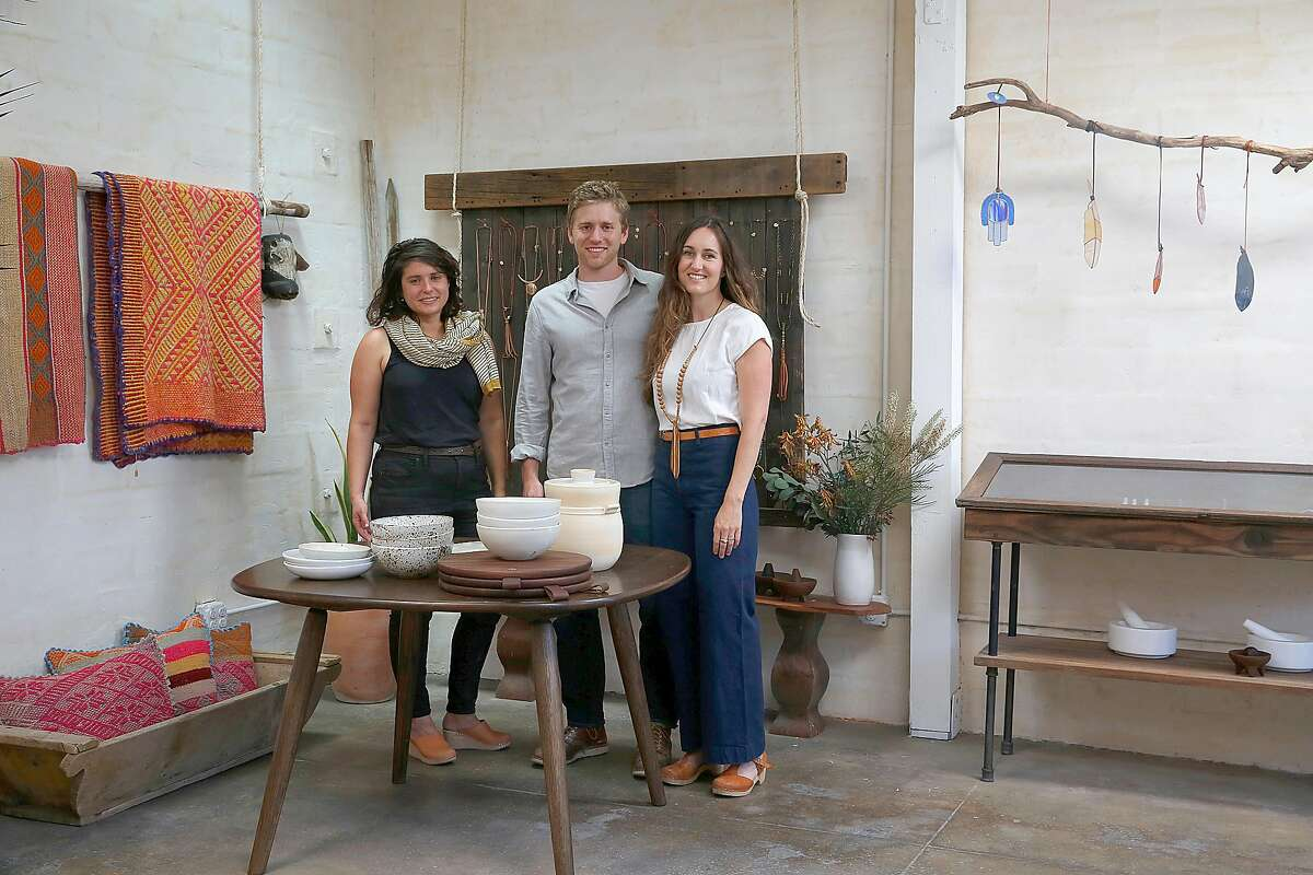 Ceramic designer Sarah Kersten (left), Dave Ball of Jacob May (middle) cutting boards and wooden tables, and his wife jewelry designer Marisa Haskell (right) of Marisa Mason Jewelry at Marisa's studio in Temescal Alley on Monday, July 24, 2017, in Oakland, Calif.