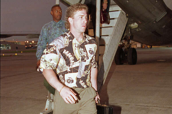 08/23/1992 - Houston Astros Jeff Bagwell disembarks from the Astros' plane at Hobby Airport on Sunday night. The Astros completed their longest road trip in franchise history, 26 games in 28 days, made necessary because the Republican National Convention took over the Astrodome for the month.