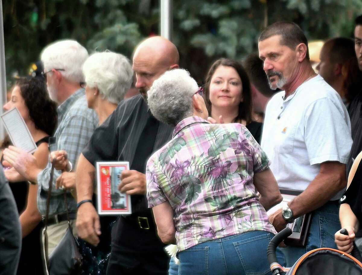 Cliff Goyette, right, talks with friends and family after a memorial service for his son Marine Maj. Caine Michael Goyette, at Soldiers & Sailors Memorial Park on Wednesday, Aug. 9, 2017, in Waterford, N.Y. Goyette was killed while on a U.S. military plane that crashed during a training mission in Mississippi. (Hans Pennink / Special to the Times Union) ORG XMIT: HP105