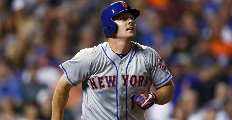 FILE - In this Aug. 1, 2017, file photo, New York Mets' Jay Bruce watches his solo home run off Colorado Rockies relief pitcher Chris Rusin during a baseball game in Denver. A person familiar with the deal says the Cleveland Indians have agreed to acquire outfielder Bruce from the Mets. The person spoke to The Associated Press on condition of anonymity Wednesday, Aug. 9, because the trade had not been announced. (AP Photo/David Zalubowski, File) Photo: David Zalubowski/Associated Press