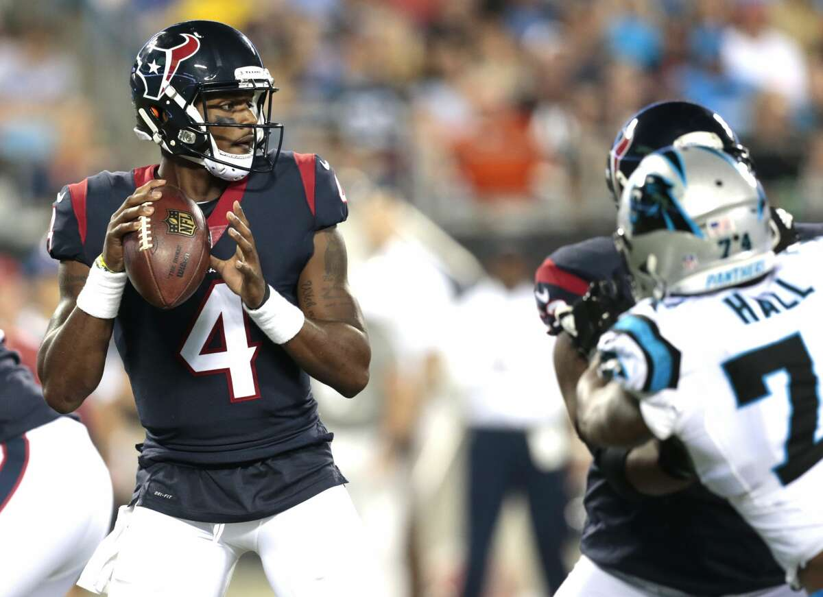 Houston Texans quarterback Deshaun Watson (4) drops back to pass against the Carolina Panthers during the third quarter of an NFL pre-season football game at Bank of America Stadium on Wednesday, Aug. 9, 2017, in Charlotte. ( Brett Coomer / Houston Chronicle )