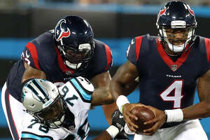 Houston Texans quarterback Deshaun Watson (4) avoids a sack as he breaks away from Carolina Panthers offensive tackle Blaine Clausell (76) during the third quarter of an NFL pre-season football game at Bank of America Stadium on Wednesday, Aug. 9, 2017, in Charlotte. ( Brett Coomer / Houston Chronicle )