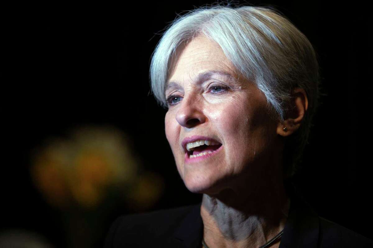 FILE - In this Oct. 6, 2016 file photo, Green party presidential candidate Jill Stein meets her supporters during a campaign stop in Oakland, Calif. (AP Photo/D. Ross Cameron)