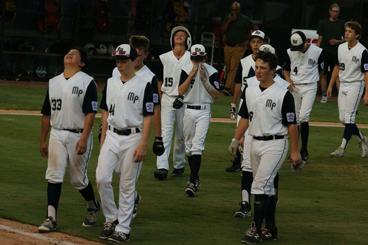McAllister Park players are dejected as they walk off the field after losing to Lufkin on Wednesday night in Waco.