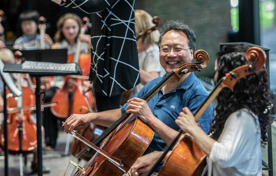 Yo-Yo Ma joined approximately 100 Capital Region cellists of all ages and abilities played with world-famous cellist Yo-Yo Ma on SPACOs amphitheatre stage to participate in a OPlayINO - a unique, shared music making event, akin to a rehearsal.  A regular feature of the OrchestraOs season in Philadelphia, this will be the first PlayIN at SPAC Wednesday  Aug. 9, 2017 in Saratoga Springs, N.Y.  (Skip Dickstein/Times Union) Photo: SKIP DICKSTEIN / 20041182A