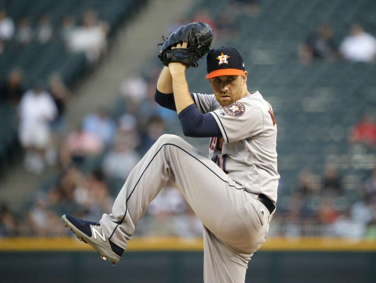 Houston Astros starting pitcher Collin McHugh winds up during the first inning of the team's baseball game against the Chicago White Sox Wednesday, Aug. 9, 2017, in Chicago. (AP Photo/Charles Rex Arbogast)
