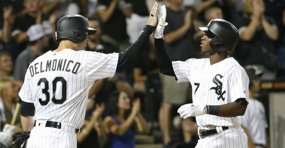Chicago White Sox's Tim Anderson (7) celebrates his two-run home run with Nicky Delmonico during the fifth inning of the team's baseball game against the Houston Astros on Wednesday, Aug. 9, 2017, in Chicago. (AP Photo/Charles Rex Arbogast) Photo: Charles Rex Arbogast/Associated Press