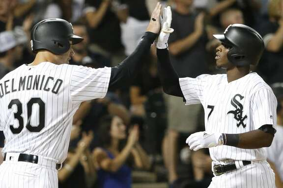 Chicago White Sox's Tim Anderson (7) celebrates his two-run home run with Nicky Delmonico during the fifth inning of the team's baseball game against the Houston Astros on Wednesday, Aug. 9, 2017, in Chicago. (AP Photo/Charles Rex Arbogast)