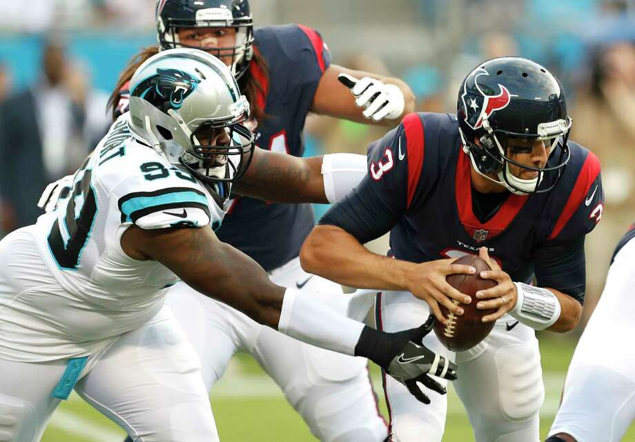 Texans quarterback Tom Savage (3) tries to evade Panthers defensive tackle Kawann Short in the first quarter of Wednesday's preseason opener. Photo: Brett Coomer, Staff / © 2017 Houston Chronicle}