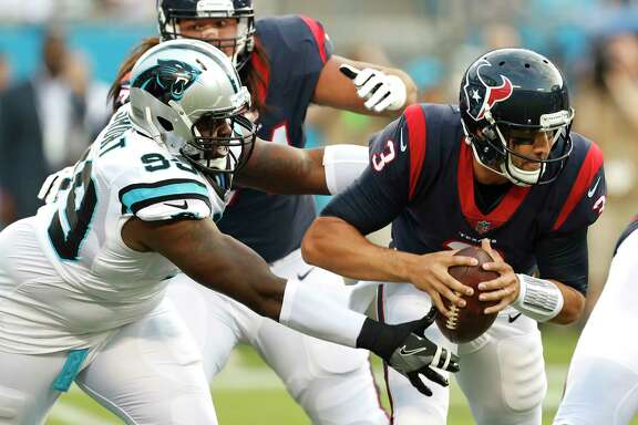 Texans quarterback Tom Savage (3) tries to evade Panthers defensive tackle Kawann Short in the first quarter of Wednesday's preseason opener.