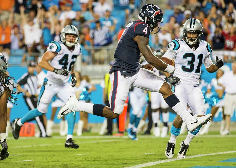 Houston Texans quarterback Deshaun Watson (4) leaps into the end zone for a 15-yard touchdown run against the Carolina Panthers during the third quarter of an NFL pre-season football game at Bank of America Stadium on Wednesday, Aug. 9, 2017, in Charlotte. ( Brett Coomer / Houston Chronicle ) Photo: Brett Coomer, Staff / © 2017 Houston Chronicle}