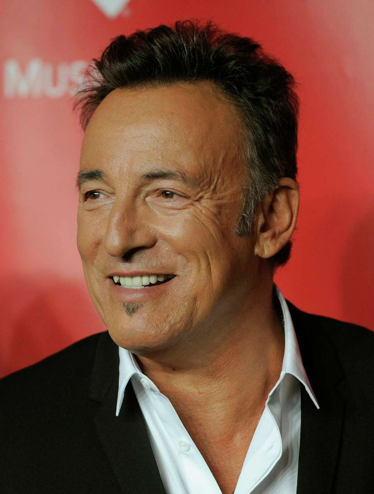 Honoree Bruce Springsteen arrives at his MusiCares Person of the Year tribute at the Los Angeles Convention Center on Friday Feb. 8, 2013, in Los Angeles. (Photo by Chris Pizzello/Invision/AP)