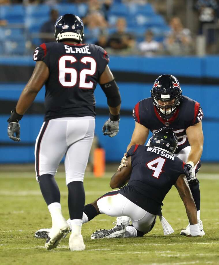 Houston Texans center Greg Mancz (65) picks up quarterback Deshaun Watson (4) after he was sacked by the Carolina Panthers defense during the fourth quarter of an NFL pre-season football game at Bank of America Stadium on Wednesday, Aug. 9, 2017, in Charlotte. ( Brett Coomer / Houston Chronicle ) Photo: Brett Coomer/Houston Chronicle