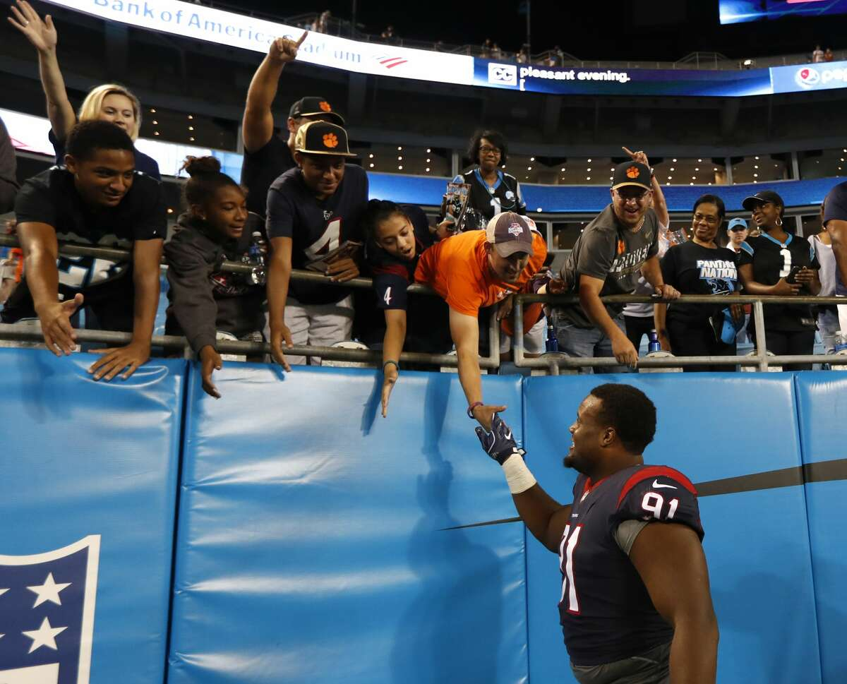 Houston Texans defensive tackle Carlos Watkins (91) high fives fans as he leaves the field following the Texans 27-17 loss to the Carolina Panthers at Bank of America Stadium on Wednesday, Aug. 9, 2017, in Charlotte. ( Brett Coomer / Houston Chronicle )