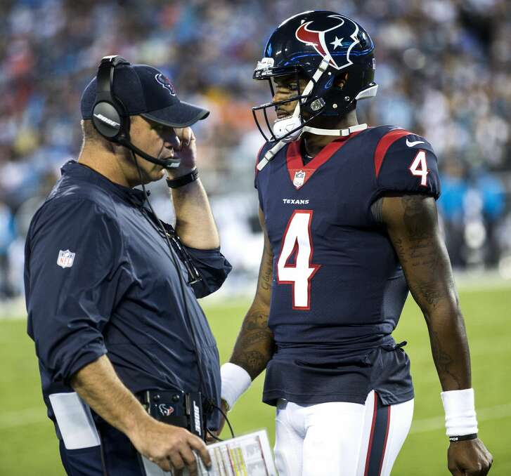 Houston Texans quarterback Deshaun Watson (4) walks past Texans head coach Bill O'Brien during the first half of an NFL pre-season football game against the Carolina Panthers at Bank of America Stadium on Wednesday, Aug. 9, 2017, in Charlotte. ( Brett Coomer / Houston Chronicle )