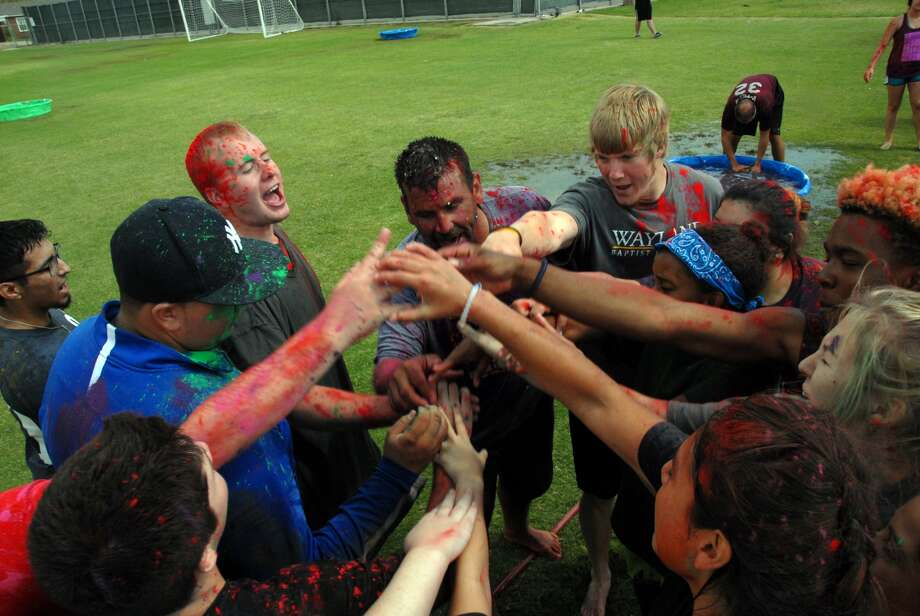 A Wayland K Family breaks their huddle during the Messy Games at Koinonia in 2016. Messy Games is always a fun when students get messy. Koinonia, Wayland's orientation weekend for new students, start Friday, Aug. 18, as students move into the dorms.
