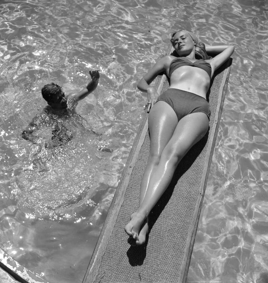 1950:  A woman sunbathes on a diving board at Acapulco Photo: Three Lions/Getty Images