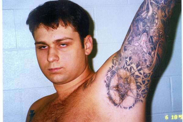 FILE - This photo of murder defendant John William King, showing some of his tattoos, was entered into evidence Wednesday, Feb. 17, 1999, in Jasper, Texas. King is one of three white men charged with capital murder in the dragging death of James Byrd Jr. (AP Photo/Jasper County District Attorney's Office, POOL)