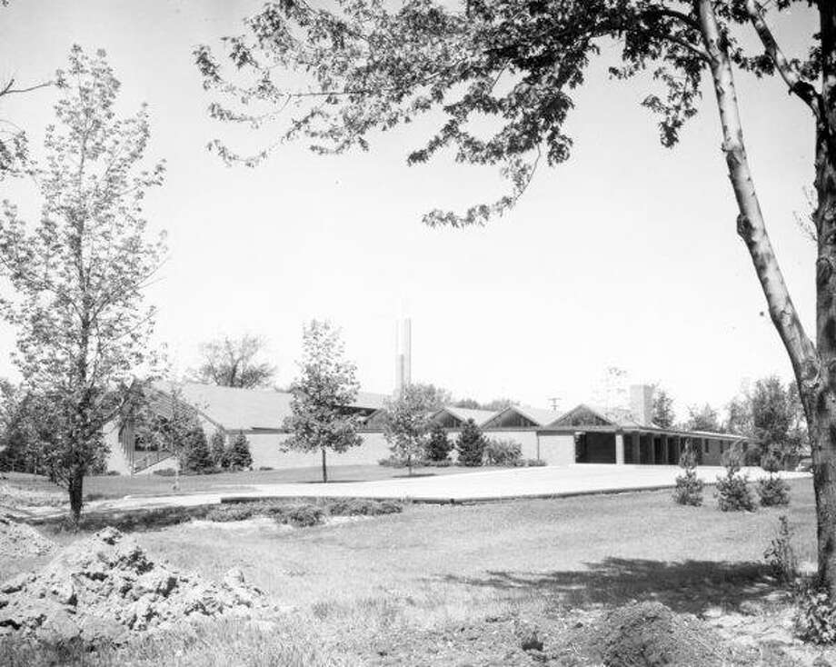 Alden B. Dow was hired to design the current sanctuary of St. John's Episcopal Church, located at 405 N. Saginaw Road. By the building's dedication in 1952, accounts show 253 families attended services. (Daily News file photo)