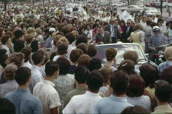 """The caption of this photo, which ran on the front page of the June 17, 1965, San Antonio Express, read: """"FRIENDLY MOB SCENE — Somewhere in the middle of this friendly mob of girls is Astronaut Ed White. The girls, mostly employees at USAA Building on Broadway Street, stopped the motorcade and surrounded White's car. White, visibly pleased by the demonstration, shook hands for several minutes before the entourage could move on to the downtown area."""""""