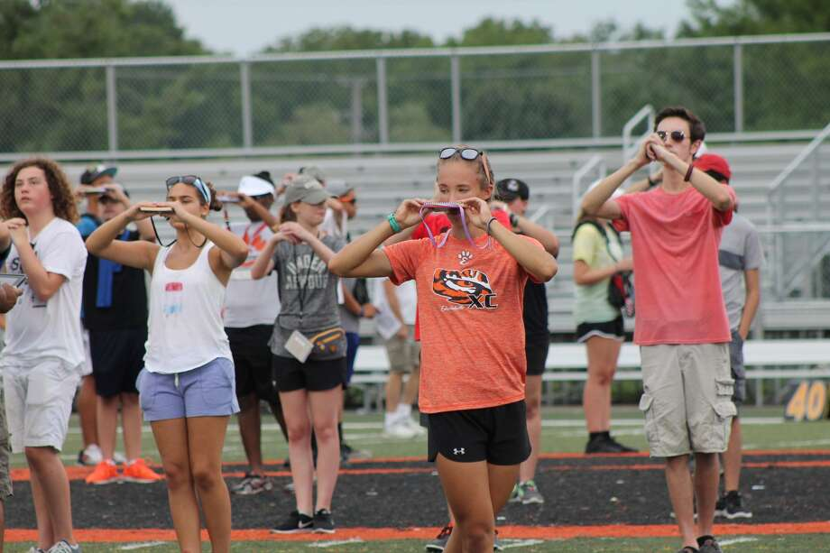 "Members of the Edwardsville Tiger Marching Band rehearse during an evening session of this year's band camp. At 7:30 p.m. Friday, Aug. 11, the band will present an exhibition of this year's program, titled ""Confined,"" at the Edwardsville Sports Complex. The exhibition is free and open to the public Photo: Bill Tucker"