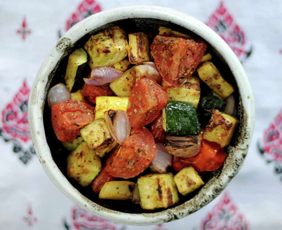 A grilled or broiled ratatouille of summer vegetables takes on a ton of flavor when a barbecue rub is applied. Photo: Paul Stephen /San Antonio Express-News