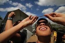 Looking directly at the sun during an eclipse can cause severe eye damage. Here, Filipino students use welders glass to safely view a partial solar eclipse March 9, 2016.