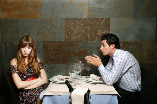 Young couple with relationship difficulties at a restaurant.