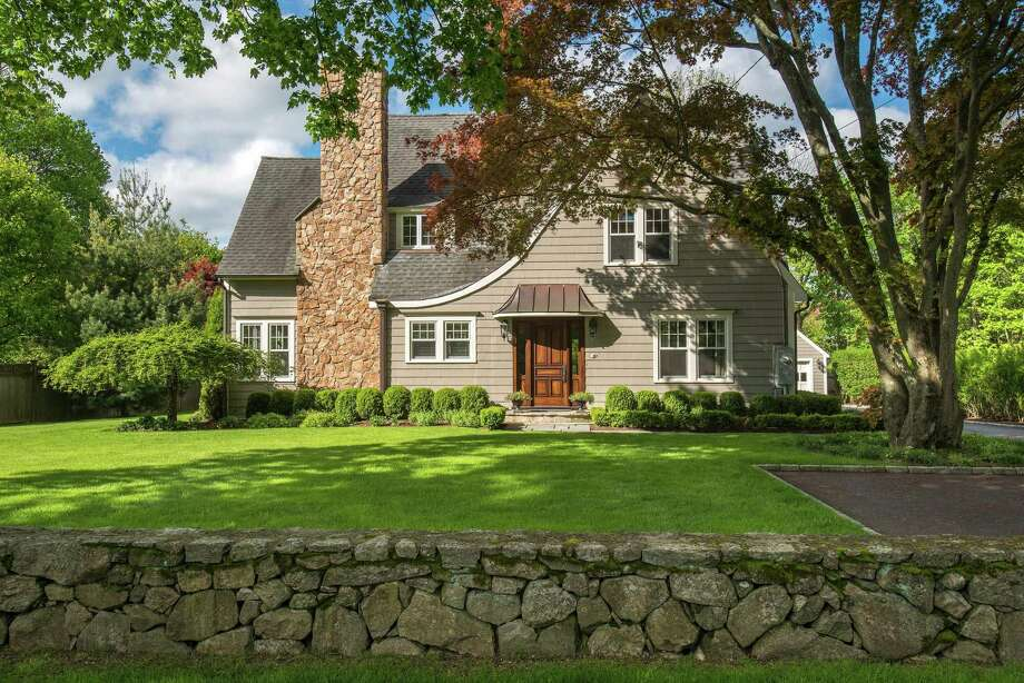 From the outside, the home at 11 Old Hill Road in Westport, Conn. looks small, like a quaint fairy tale cottage, an image befitting a property that was built in 1928. But the exterior is deceptive, and opens into a modern, spacious, but intimate, 3,358-square-foot home. Photo: Steve Rossi / Contributed Photo / © SR Photo, LLC All Rights Reserved / Connecticut Post contributed