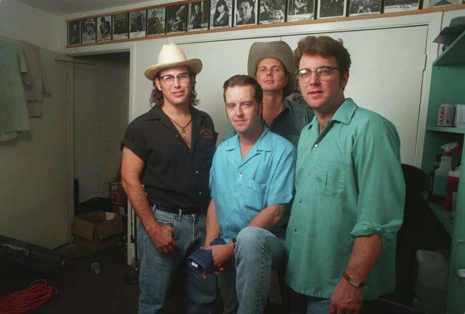 The Hollisters in 1996, with Eric Danheim pictured far right. Danheim died earlier this month after years of playing in Texas bands and building guitars used by Texas musicians. Photo: CHRISTOBAL PEREZ, STAFF / HOUSTON CHRONICLE