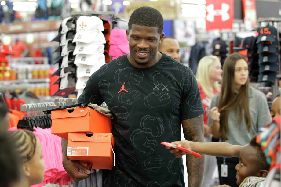 Former Texan Andre Johnson was smiling after treating 30 children from area boys and girls clubs to a $100 shopping spree Thursday, Aug. 10, 2017, in Houston. Each child received a $100 Academy store gift card to buy back to school items. Photo: Steve Gonzales, Houston Chronicle / © 2017 Houston Chronicle