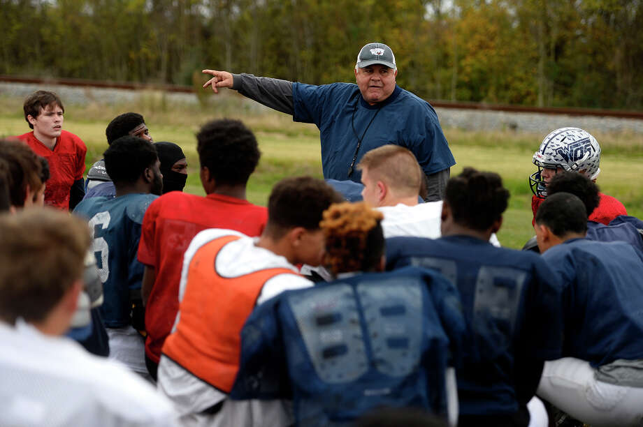 West Orange-Stark football coach Cornel Thompson talks with his players during practice on Wednesday.  Photo taken Wednesday 12/14/16 Ryan Pelham/The Enterprise Photo: Ryan Pelham / ©2016 The Beaumont Enterprise/Ryan Pelham