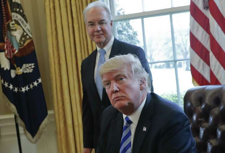 File photo of President Donald Trump with Health and Human Services Secretary Tom Price in the Oval Office of the White House. Insurers are being quite explicit about citing the Trump administration's hostile policy messages as a substantial reason for higher premiums.