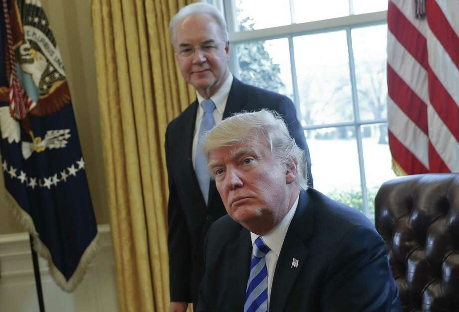 File photo of President Donald Trump with Health and Human Services Secretary Tom Price in the Oval Office of the White House. Insurers are being quite explicit about citing the Trump administration's hostile policy messages as a substantial reason for higher premiums. Photo: Pablo Martinez Monsivais /Associated Press / Copyright 2017 The Associated Press. All rights reserved.