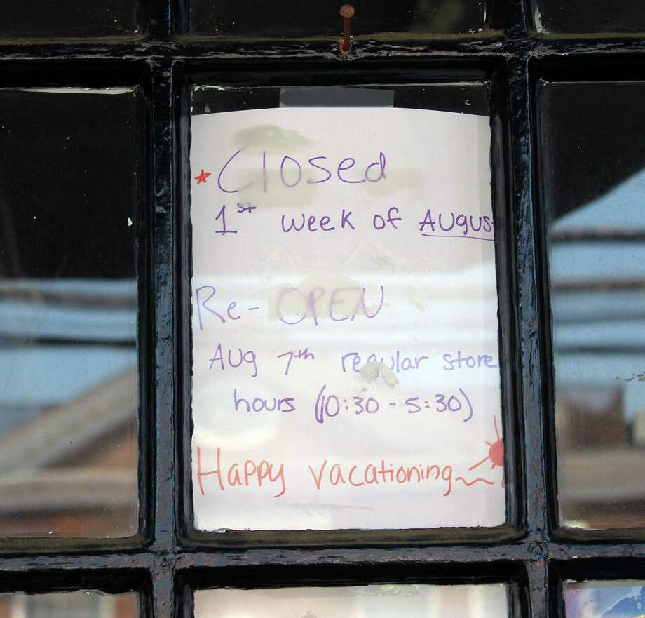 A sign in the door of Spree in Darien on Aug. 3. Photo: Erin Kayata / Hearst Connecticut Media / Darien News