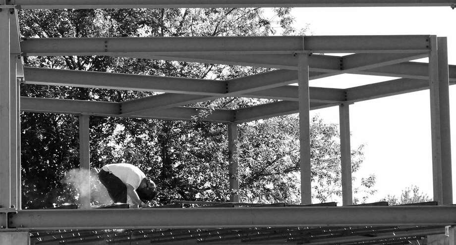 Hard at work on a building under construction on Turney Road. Photo: Genevieve Reilly / Hearst Connecticut Media / Fairfield Citizen